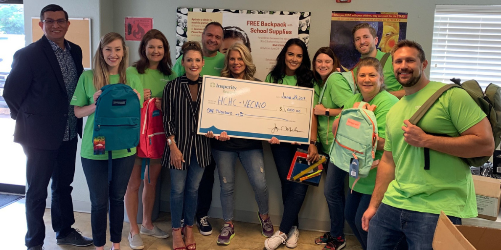 Representatives from Insperity at Vecino's Denver Harbor Clinic supporting the 2019 backpack program.